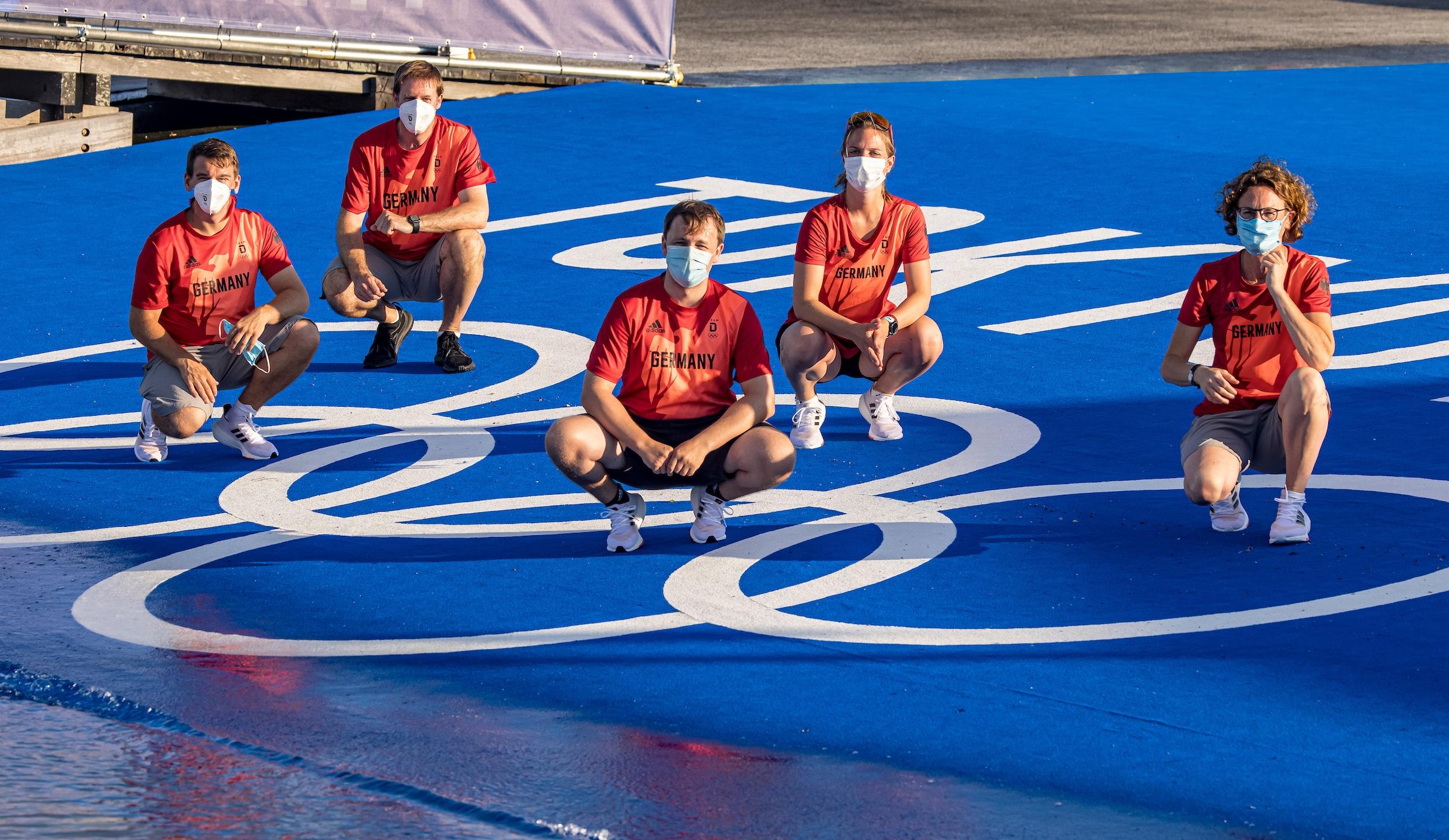 Team hinter dem Team Olympia
